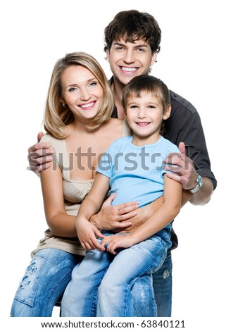 Happy young family with pretty child posing on white background