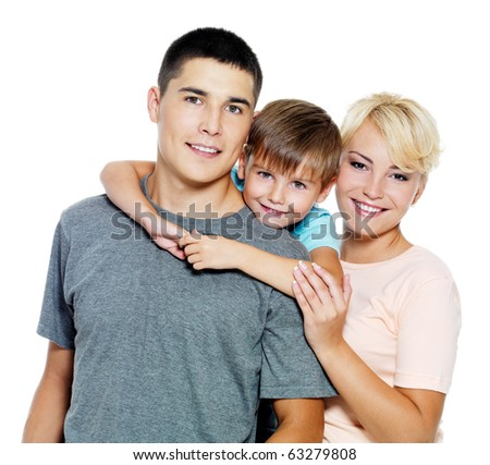 Happy young family with son of 6 years posing over white background
