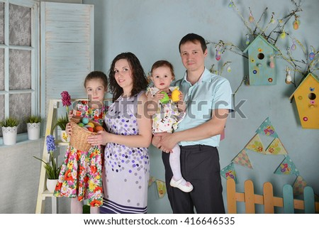 Happy young family with two pretty girls posing - stock photo