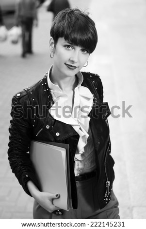 Happy young fashion business woman with a folders  - stock photo