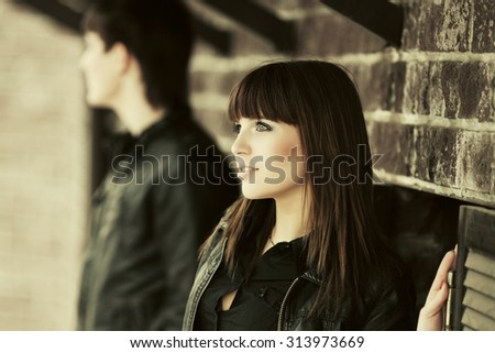 Happy young fashion couple in love at the brick wall - stock photo