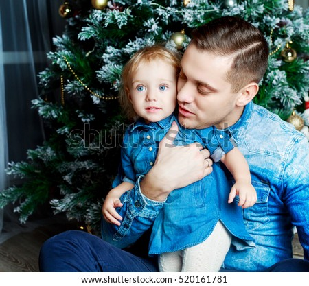 happy young father and his daughter at home with Christmas tree