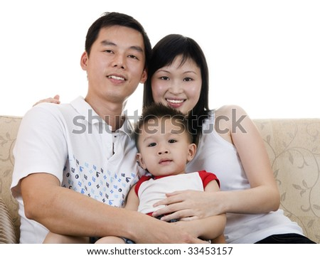 Happy young father, mother and son. - stock photo