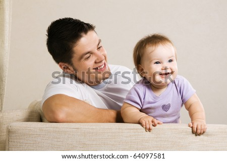 Happy young father with his little daughter having fun at home - stock photo