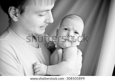 Happy young father with little baby - stock photo