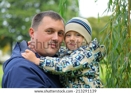happy young father with little son - stock photo
