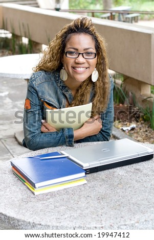 happy young female african college student - stock photo