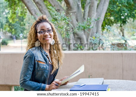 happy young female african college student