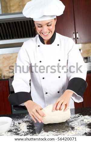 happy young female chef making dough - stock photo