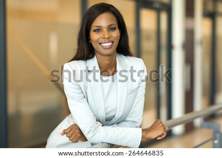 happy young female corporate worker in modern office - stock photo