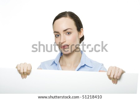 Happy young female holding big blank banner - over white background - stock photo
