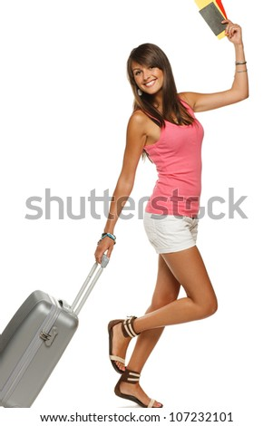 Happy young female in casual walking with the travel bag, holding passport and tickets