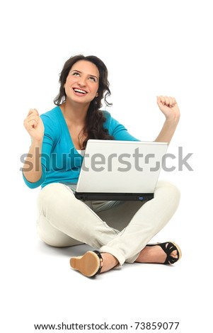 Happy young female sitting on floor using laptop - stock photo