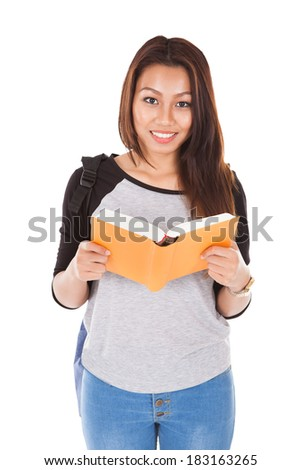 Happy young female student reading book over white background