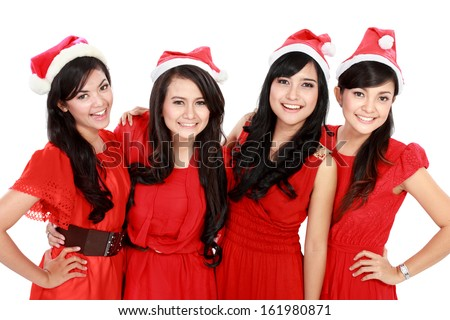 Happy young four asian woman with christmas santa hat isolated  on white background - stock photo