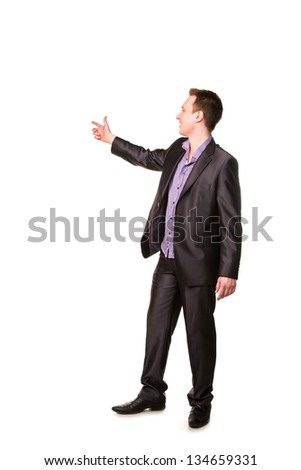 Happy young friendly smiling businessman pointing finger isolated on white - stock photo