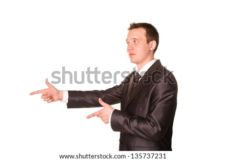 Happy young friendly smiling businessman pointing finger isolated on white