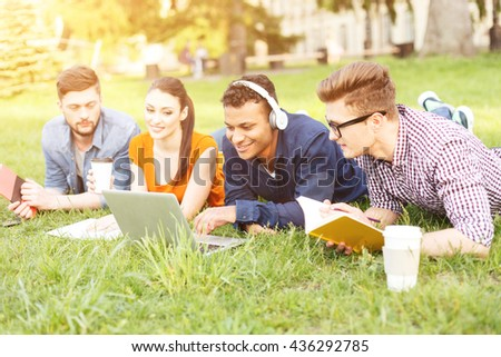 Happy young friends are resting after study - stock photo