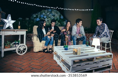 Happy young friends drinking and having fun in a outdoors party. Friendship and celebrations concept. - stock photo