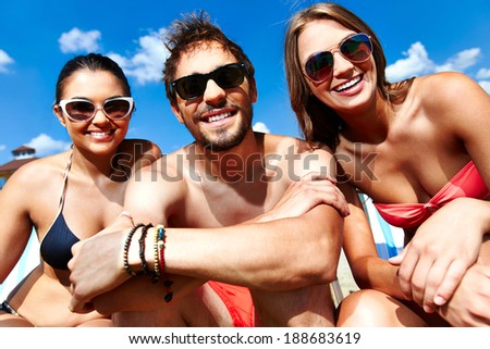 Happy young friends enjoying rest on the beach - stock photo