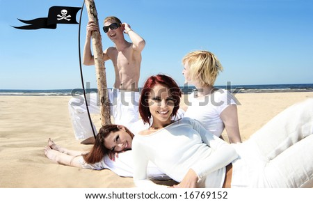 happy young friends having fun on the beach - stock photo