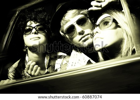 Happy young friends in the car - stock photo