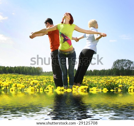 happy young friends relaxing outdoors - stock photo