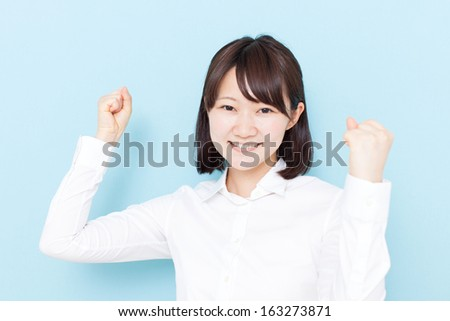 happy young girl against blue background