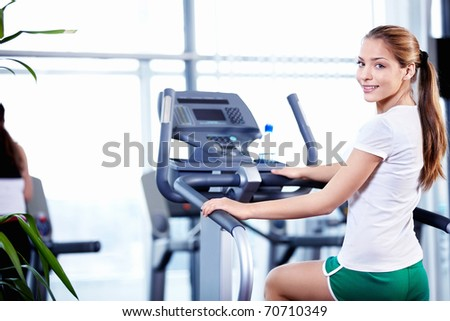 Happy young girl engaged in fitness - stock photo