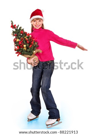 Happy young girl figure skating in Santa hat with Christmas tree. Isolated.