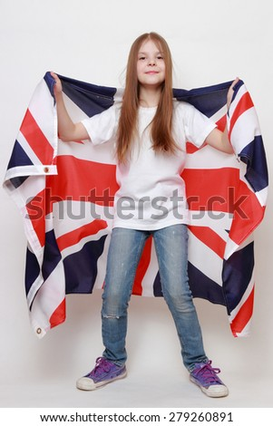 Happy young girl holding a flag of of Great Britain (British flag) - stock photo