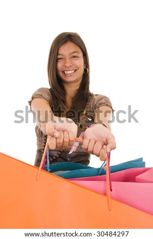 Happy young girl holding colorful shopping bags - stock photo