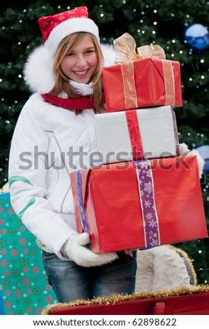 Happy young girl in Santa Claus sledge