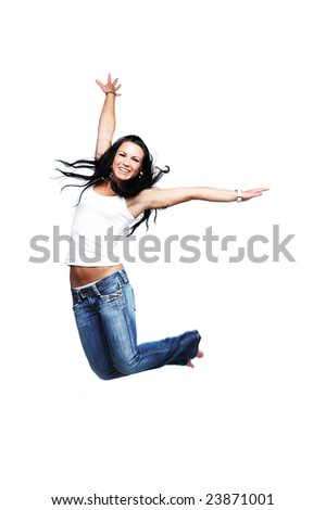 Happy young girl jumping, isolated on white, wearing white tank top, with copy space - stock photo