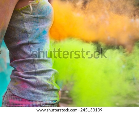 Happy young girl on holi color festival. Close up - stock photo