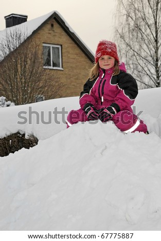Happy young girl on the snow hill - stock photo