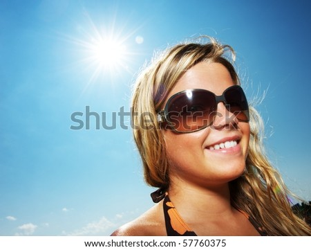Happy young girl outdoors - stock photo
