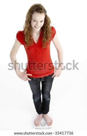 Happy Young Girl Standing On Scales