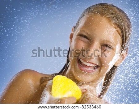 Happy Young Girl Taking Shower. Bathing - stock photo