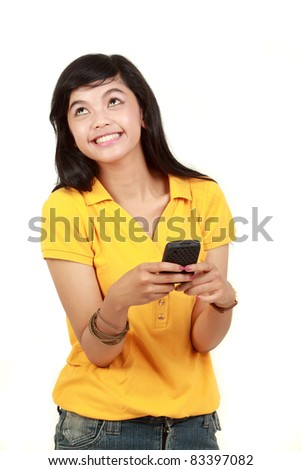 Happy young girl text message on her mobile phone - stock photo