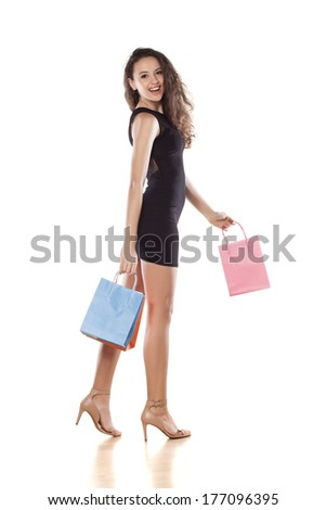 happy young girl walk with shopping bags
