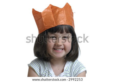 Happy young girl wearing a crown - stock photo