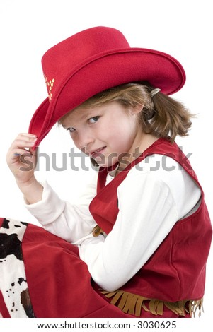 Happy young girl with a cowboy hat  and cowboy dress