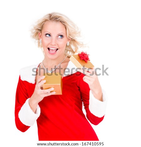 Happy young girl with Christmas gift over white background - stock photo