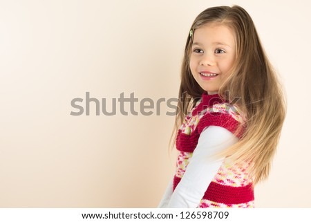 Happy Young Girl with Flowing Hair, wearing Knitted Dress