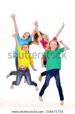 happy young girls in colorful t-shirts on white background - stock photo