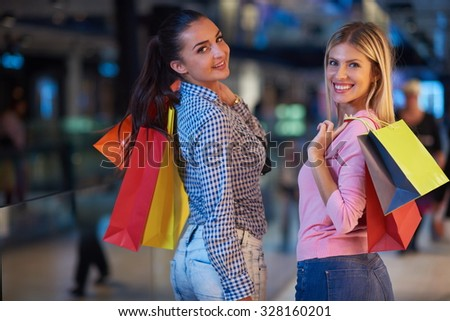 happy young girls in  shopping mall, friends having fun together