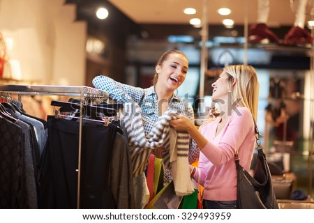 happy young girls in  shopping mall, friends having fun together - stock photo