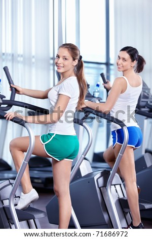 Happy young girls in the fitness club - stock photo