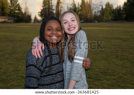 Happy young girls outside - stock photo